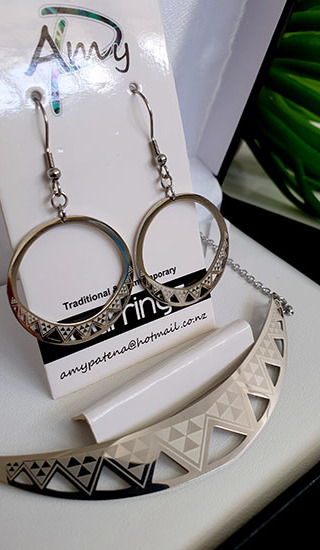 Niho Taniwha Silver halfmoon pendant with 30mm hoop earrings