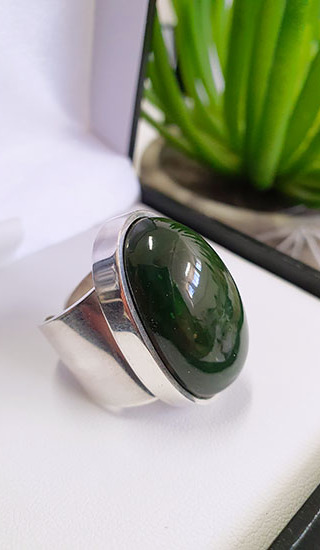 Sterling Silver Ring with Kawakawa Pounamu cabochon Primary ring size 7-8